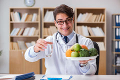 The scientist studying nutrition in various food Stock Image