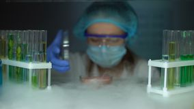 Scientist taking meat sample in petri dish from fridge, infected tissue analysis. Stock footage stock video