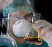 Scientist taking a probe in a labor scene  Stock Photo