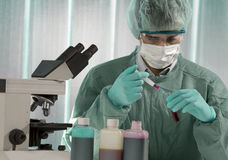 Scientist taking a probe in a labor scene with tes stock photography