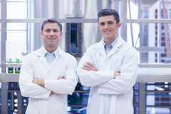 Scientist team smiling at camera with arms crossed. In the factory Royalty Free Stock Images