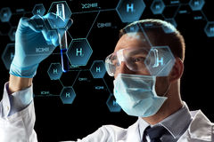 Scientist with test tube and chemical formula Royalty Free Stock Photo