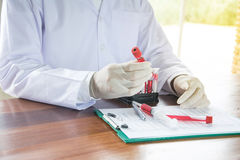 Scientist with test tube making research in clinical laboratory. Royalty Free Stock Photos
