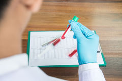 Scientist with test tube making research in clinical laboratory. Stock Photo