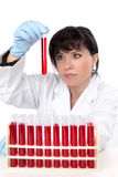 Scientist with test tubes. A female scientist sitting at desk with rack of  test tubes Stock Photography