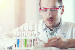 Scientist with test tubes Royalty Free Stock Image