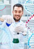 Scientist with test tubes making research in lab Royalty Free Stock Photography