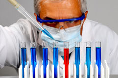 Scientist with test tubes and pipette Stock Image