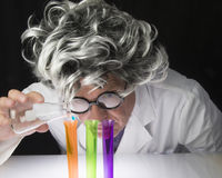 Scientist and Test Tubes Stock Photography