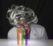 Scientist and Test Tubes Royalty Free Stock Images