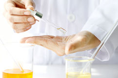 Scientist testing a new organic beauty products on hand. Stock Photo