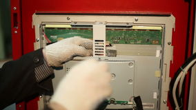 The scientist twists the screws using screwdriver in the switchboard stock video footage