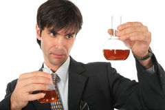 Scientist with two flasks with brown liquid Royalty Free Stock Photo