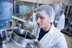 Scientist using brewer in the container Royalty Free Stock Photo