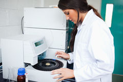 Scientist using a centrifuge Royalty Free Stock Image