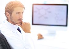 Scientist using computer and microscope in the laboratory Royalty Free Stock Photo