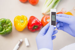 Scientist using device on vegetables Royalty Free Stock Images