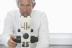 Scientist Using Microscope In Laboratory Stock Images