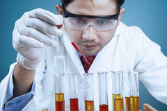 Scientist using reactants for experiment Stock Photography