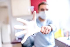 Scientist using a single-use rubber glove stock images