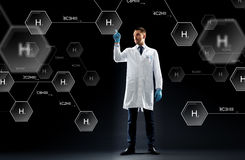 Scientist with virtual chemical formula projection Stock Photography