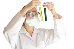 Scientist woman. Isolated scientist woman in lab coat with chemical glassware Stock Photos
