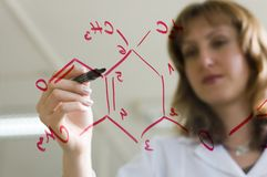 Scientist woman. Woman Scientist writing a organic  formula Stock Photos