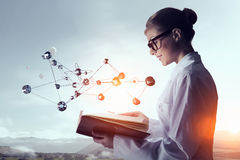 Scientist woman doing research. Mixed media Stock Images