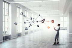 Scientist woman doing research. Mixed media Stock Photography