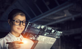 Scientist woman doing research. Mixed media stock photo