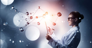 Scientist woman doing research. Mixed media Royalty Free Stock Photos