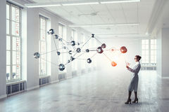 Scientist woman doing research. Mixed media Royalty Free Stock Photography