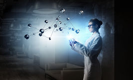 Scientist woman doing research. Mixed media Royalty Free Stock Photo