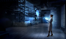 Scientist woman doing research. Mixed media Royalty Free Stock Images