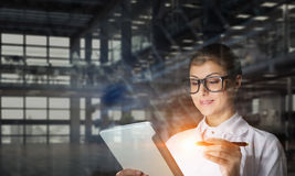 Scientist woman doing research. Mixed media Stock Image