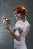 Scientist woman examine metal part concept Royalty Free Stock Photos