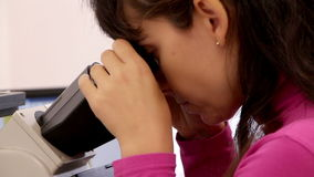 Scientist woman examining something with microscope stock video footage