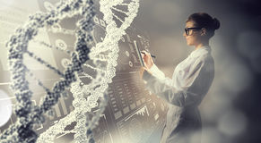 Scientist woman using tablet pc. Mixed media Stock Images