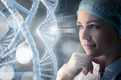 Scientist woman working in laboratory . Mixed media Stock Photography
