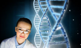 Scientist woman working in laboratory . Mixed media Royalty Free Stock Photo