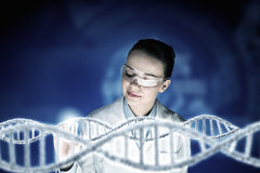 Scientist woman working in laboratory . Mixed media Stock Images