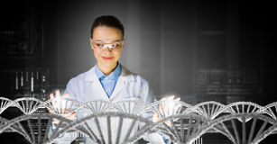 Scientist woman working in laboratory . Mixed media Royalty Free Stock Photos