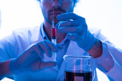 Scientist during work at modern biological laboratory. Male scientist during work at modern biological laboratory Stock Photos