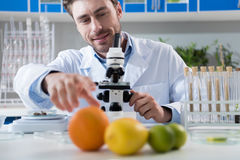 Scientist during work at modern biological laboratory. Male scientist during work at modern biological laboratory Royalty Free Stock Images