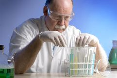 Scientist working with chemicals Royalty Free Stock Photos