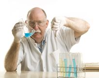 Scientist working with chemicals Stock Images