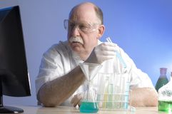Scientist working with chemicals Stock Photo