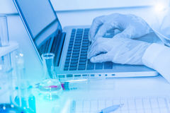 Scientist working on computer for analysis. Royalty Free Stock Image