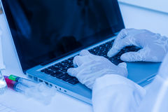 Scientist working on computer for analysis. Royalty Free Stock Photos