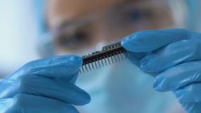 Scientist working on creation of nanochip for artificial intelligence to robots. Stock footage stock video footage